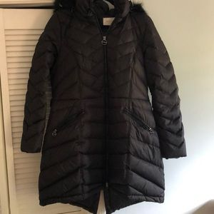 Black puffer jacket with faux fur lined hood